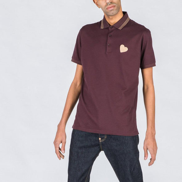Burgundy polo with heart stamp.