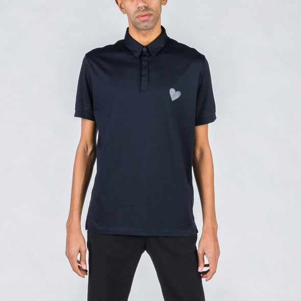 Navy blue polo with heart stamp.