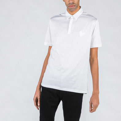 White polo with heart stamp.