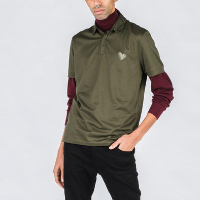 Olive green polo with heart stamp.