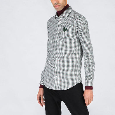 Patterned shirt with olive green heart stamp.