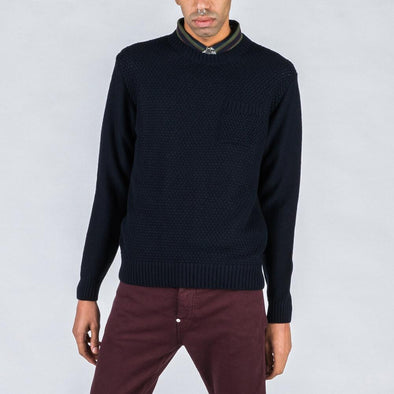 Navy blue knit with chest pocket.