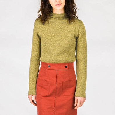 Green mock neck topwith tight sleeves.