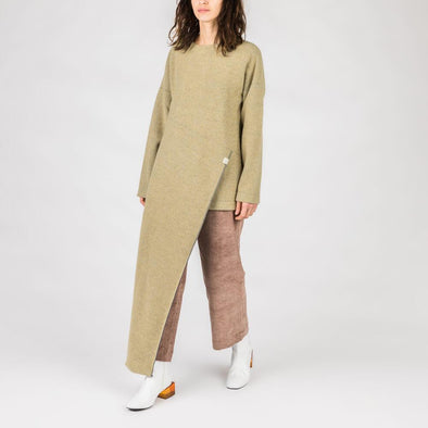Soft yellow oversized sweater with long panel on the front.