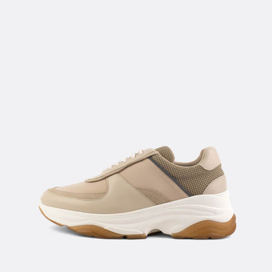 Beige leather platform runners.