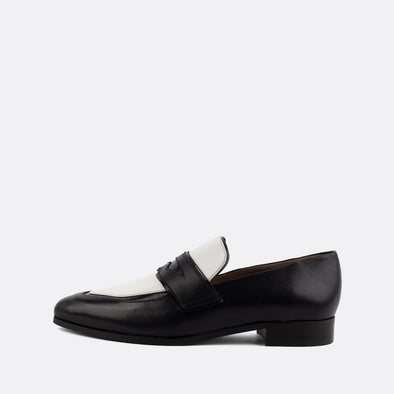 Smart leather loafers in black and white.