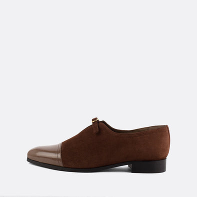 Smart brown suede loafers with leather toe.