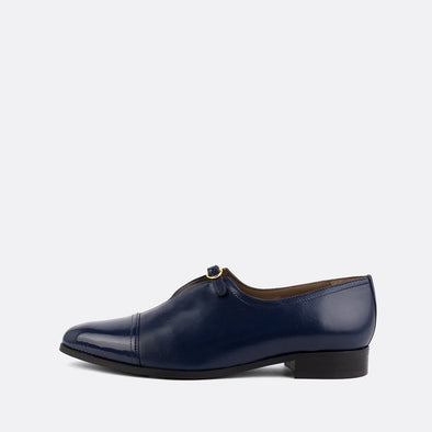 Navy blue leather smart loafers with a golden buckle.