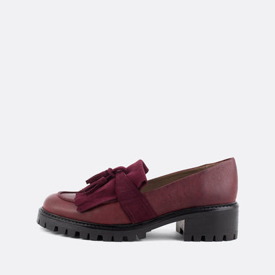 Bordeaux leather loafers with matching fringe and tassel.