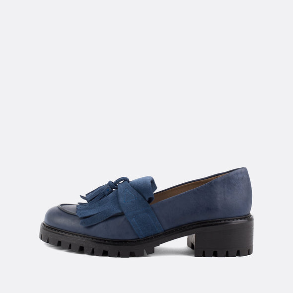 Blue leather loafers with matching fringe and tassel.