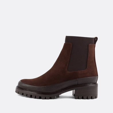 Brown suede chelsea boots with rubber outsole.