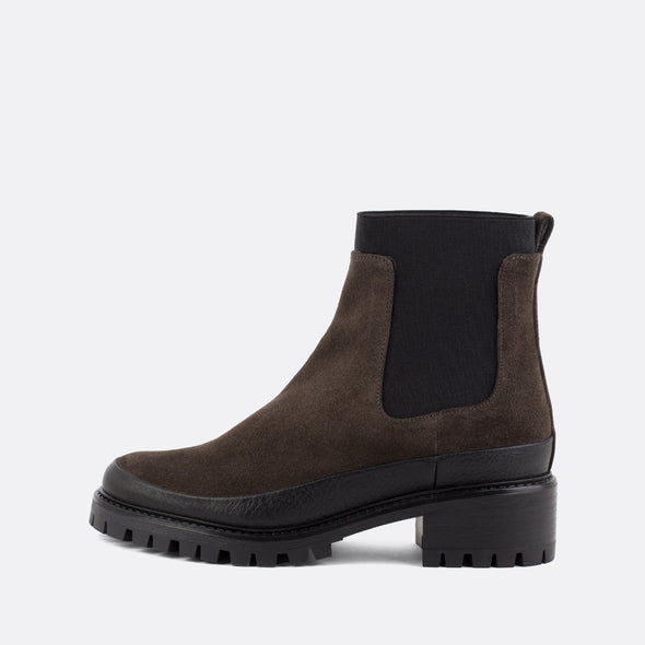 Grey and black chelsea boots with rubber outsole.