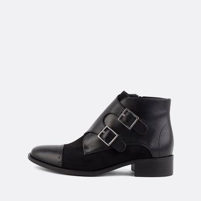 Black leather and suede boots with two side buckles.
