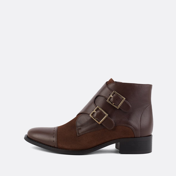 Brown leather and suede boots with two side buckles.