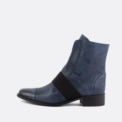 Navy blue leather boots featuring an elastic in the upper.
