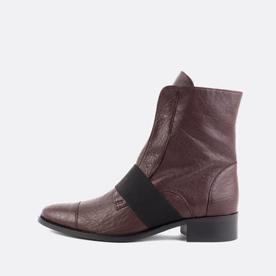 Bordeaux leather boots featuring an elastic in the upper.