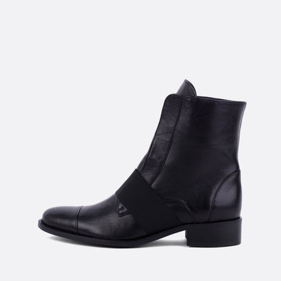 Black leather boots featuring an elastic in the upper.