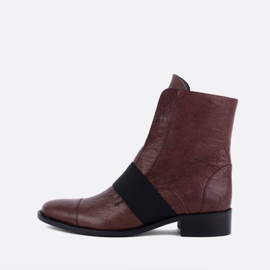 Brown leather boots featuring an elastic in the upper.