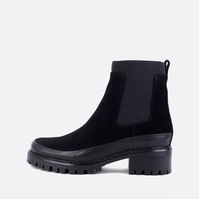 Black suede chelsea boots with rubber outsole.
