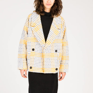 Straight cut coat in yellow check print wool mix.