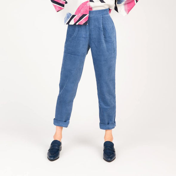 Blue high-waisted trousers in soft corduroy.