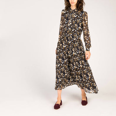Blue foliate print fluid dress with long sleeves.