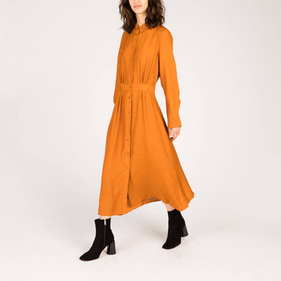 Orange long shirt-dress with ochre thin stripes.