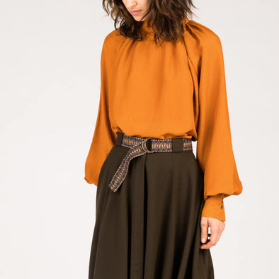 Orange blouse with baloon sleeves.