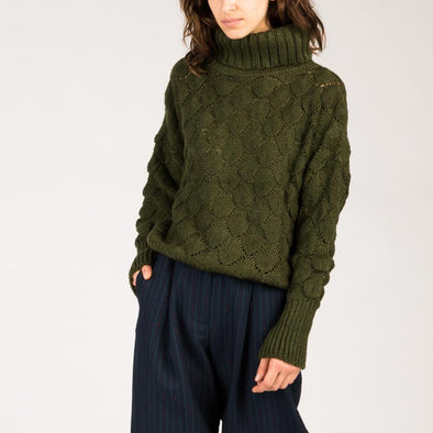 Large high collar sweater in olive green.