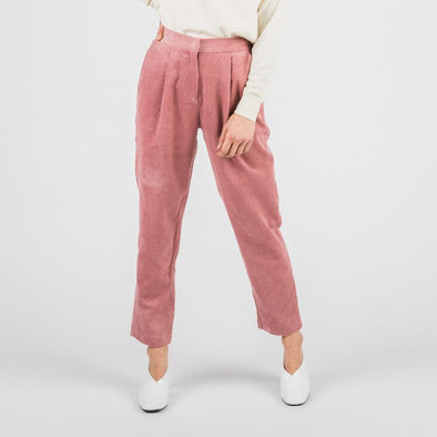 Pink corduroy high waisted trousers with two side pockets.