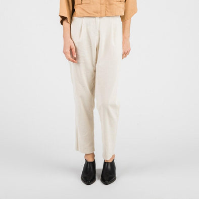White corduroy high waisted trousers with two side pockets.