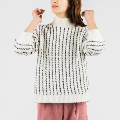 Oversized knit with black stripes on ecru background.