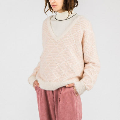 Light pink knit with flared cut and v-neck.