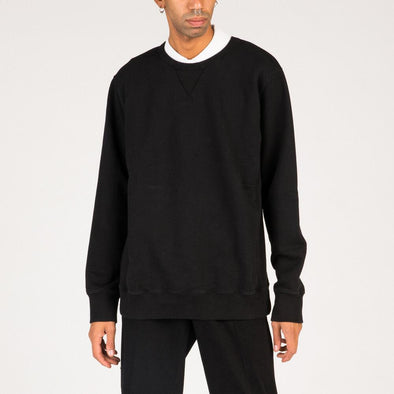 Black crewneck sweatshirt with ribbed collar, cuffs and hemline.