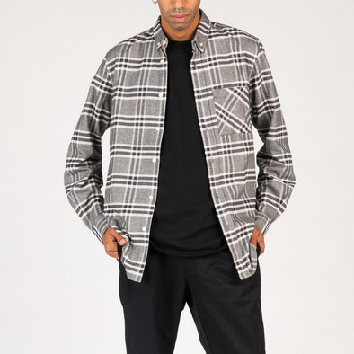 Oversized check button-down flannel shirt in several shades of grey and white.