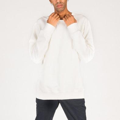 White crewneck sweatshirt with ribbed collar, cuffs and hemline.