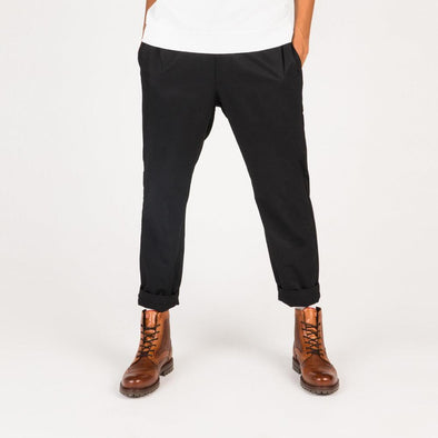 Relaxed fit black trousers with drawstring waistband and a technical feel.