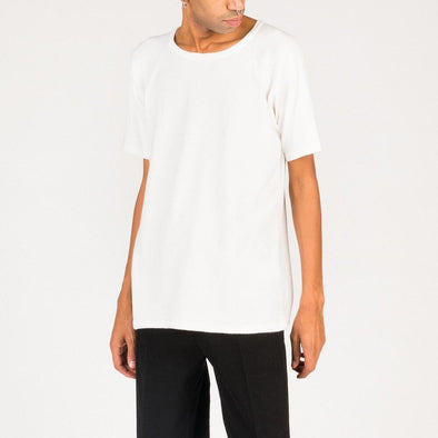 Minimalist white cotton tee.
