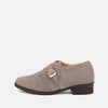 Taupe suede shoes with strap and golden buckle.