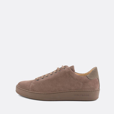 Casual almond suede low-top sneakers with taupe panels and sole.
