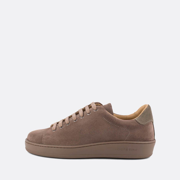 Casual almond suede low-top sneakers with taupe panels.