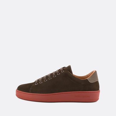 Casual brown suede low-top sneakers with grey panels and red sole.
