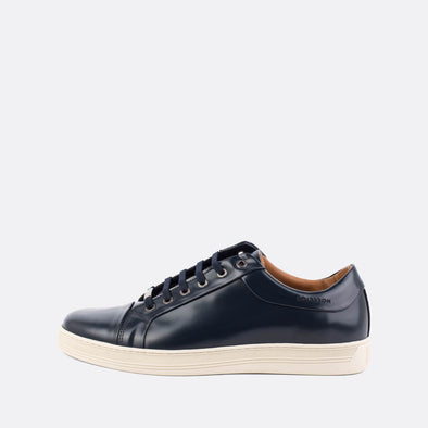 Low-top minimalist sneakers in blue polished leather.