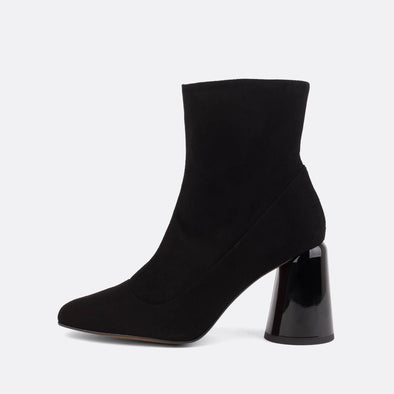 Square toe heeled ankle boots in black suede.
