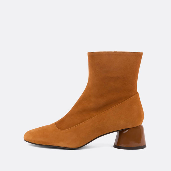 Square toe heeled ankle boots in camel suede.