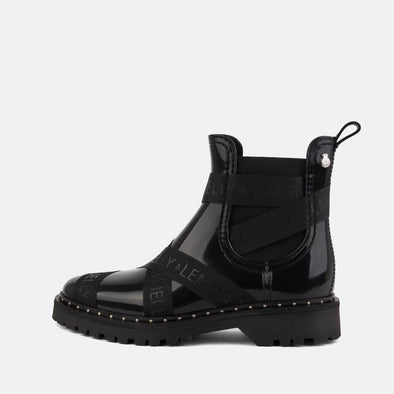 100% animal friendly black ankle boots with shiny finishing and grosgrain straps across the upper.