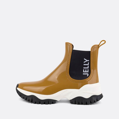 100% animal friendly sporty boots wrapped in a warm yellow glow.