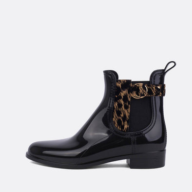 Black rain boots with animal print detail.