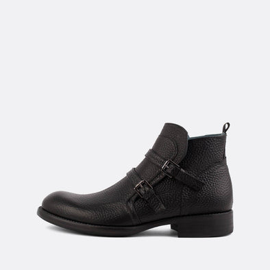Black textured leather boots with two straps.