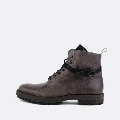 Grey leather boots with black strap made in collab in Nelson Vieira.